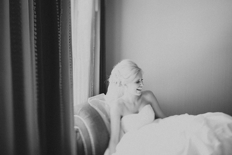 bride laughing, black and white wedding